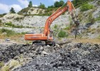escavatore cingolato DOOSAN DX 340 LCV con martello demolitore INDECO HP 4000