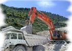 escavatore cingolato HITACHI RX 700 e dumper Perlini 366